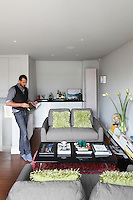 Designer Jsen Wintle in the living room of his narrow London townhouse