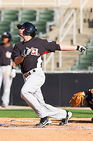 Jonathan Roof #3 of the Hickory Crawdads follows through on his swing against the Kannapolis Intimidators at Fieldcrest Cannon Stadium on April 17, 2011 in Kannapolis, North Carolina.   Photo by Brian Westerholt / Four Seam Images