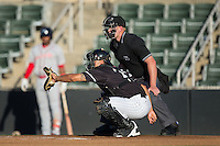 Kannapolis Intimidators catcher Seby Zavala (21) sets a target as home plate umpire Mike Carroll looks on during the game against the Greenville Drive at Intimidators Stadium on June 8, 2016 in Kannapolis, North Carolina.  The Intimidators defeated the Drive 3-2.  (Brian Westerholt/Four Seam Images)
