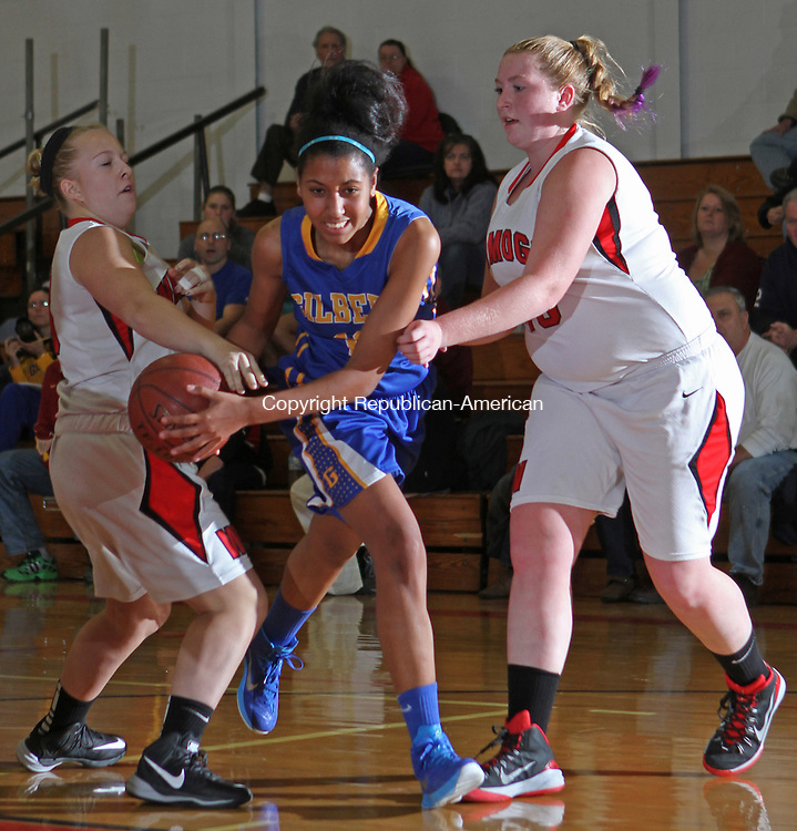 Litchfield, CT-122014MK01 Gilbert's Shachelly DeLapaz (#12) draws a foul from Wamogo's Emma Caldwell (#13) and Danielle Tillmann (#43) as she drives to the basket Saturday afternoon at Wamogo High School.  Gilbert defeated Wamogo 56-27. Michael Kabelka Republican-American