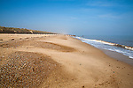 Cross section view of wide sandy beach with waves, Horsey, Norfolk, England