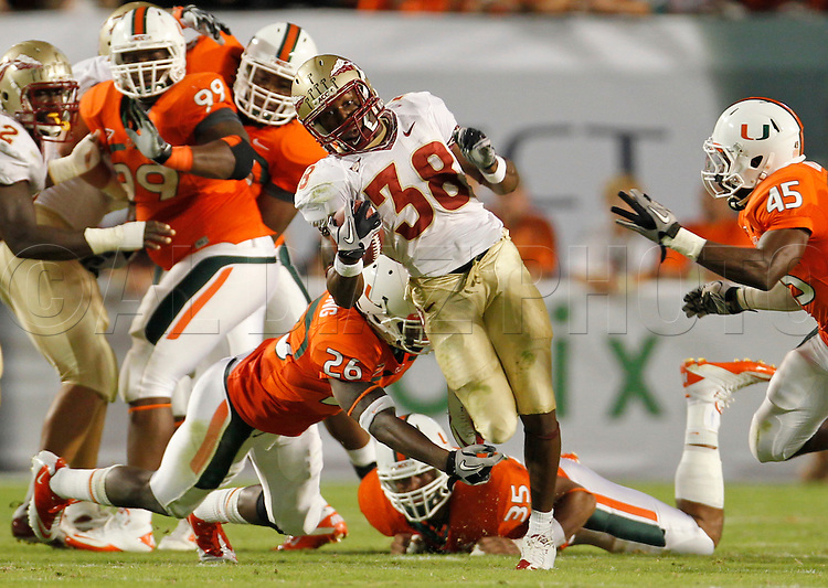 FSU's Jermaine Thomas runs for a first down in the first half during  the University of Miami vs Florida State University on Saturday October 9, 2010.