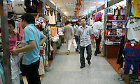 Shoppers peruse various stalls in a clothing market in Beijing, China on May 16, 2006.
