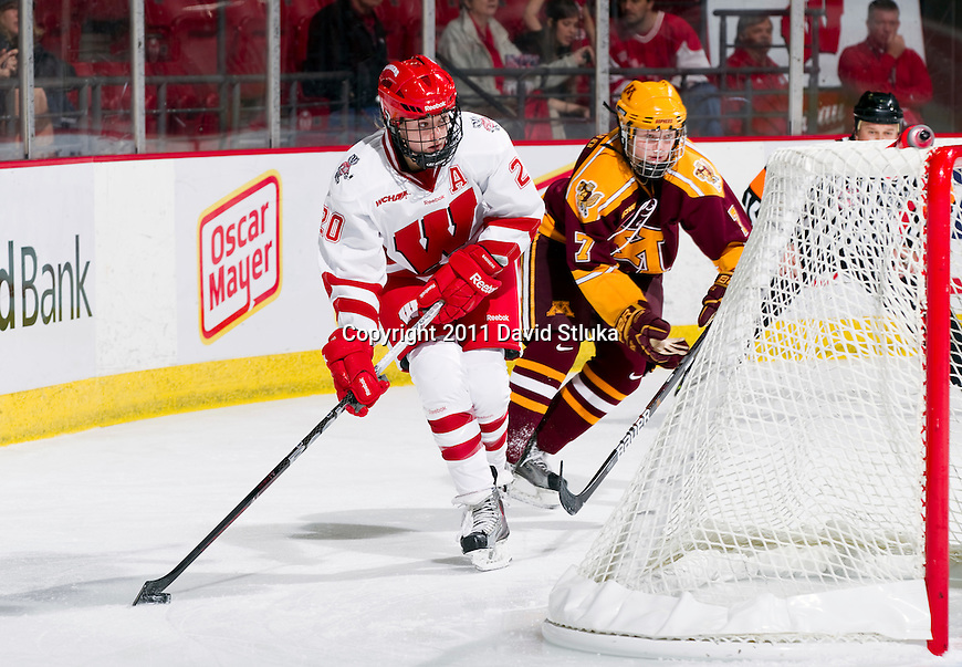 Wisconsin Badgers Brooke Ammerman (20) handles the puck during an NCAA women's hockey game against the Minnesota Golden Gophers on October 14, 2011 in Madison, Wisconsin. The Badgers won 3-2. (Photo by David Stluka)