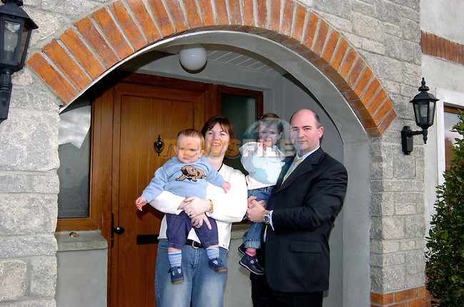 Martin Cassidy and his wife Fiona with thier two children Oonagh and Cormac at thier home in Mullingar. Martin travels to work in Dublin every day. Photo: Colin Bell / Newsfile