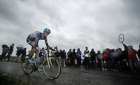 former Paris-Roubaix winner Johan Vansummeren (BEL/Garmin-Sharp) over the sector 6 cobbles<br /> <br /> 2014 Tour de France<br /> stage 5: Ypres/Ieper (BEL) - Arenberg Porte du Hainaut (155km)