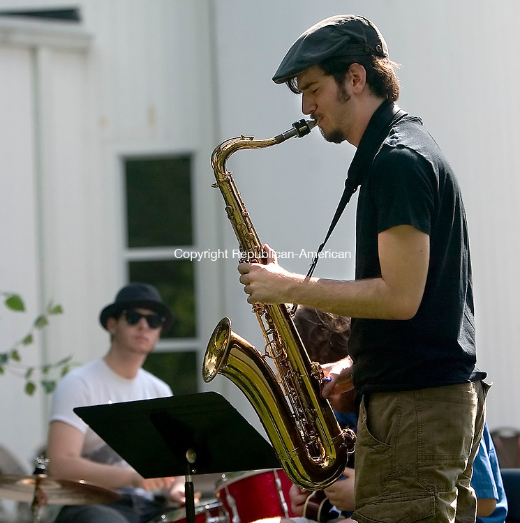 SOUTHBURY, CT- 24 AUGUST 2008- 082408JT07-<br /> FOR COUNTRY LIFE: Jeremy Hodge of Newtown plays the saxophone with fellow band members Sean Penchoff on drums and Andrew Vince, partially obscured, on guitar at the campus of B'Nai Israel in Southbury during the congregation's annual picnic on Sunday.<br /> Josalee Thrift / Republican-American