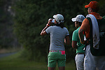 Sophia Sheridan (left) and Nontaya Srisawang (right) await there turn on the 18th tee before night arrives at Alliance Bank Classic Golf in Syracuse, NY.