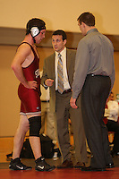 STANFORD, CA - FEBRUARY 6:  (L-R) 184 pounds Jake Johnson, head coach Jason Borrelli, and assistant coach Ray Blake of the Stanford Cardinal during Stanford's 20-19 win against the Arizona State Sun Devils on February 6, 2009 at Burnham Pavilion in Stanford, California.