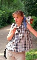 Woman age 25 enjoying the  taste of sunglasses ala carte.  Chechocinek Poland