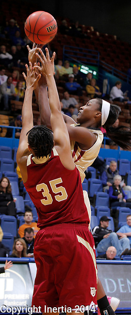 SIOUX FALLS, SD - MARCH 10:  Akilah Sims #30 of IUPUI shoots over Denver defender Desiree Hunter #35 during their semifinal game at the 2014 Summit League Basketball Championships Monday at the Sioux Falls Arena. (Photo by Dick Carlson/Inertia)