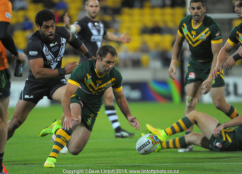 Cameron Smith chases loose ball under pressure from Adam Blair during the Four Nations rugby league final between the NZ Kiwis and Australia Kangaroos at Westpac Stadium, Wellington on Saturday, 15 November 2014. Photo: Dave Lintott / lintottphoto.co.nz