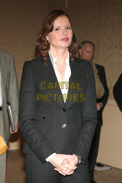 GEENA DAVIS.Announcement of 2006 Cecil B. DeMille Award Recipient and Miss Golden Globe held at the Beverly Hilton Hotel, Beverly Hills, California.  .November 16th, 2005.Photo: Eric Curtis/AdMedia/Capital Pictures.Ref: EC/ADM.half length grey gray pinstripe suit jacket.www.capitalpictures.com.sales@capitalpictures.com.© Capital Pictures.