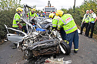 Firefighters at the scene of a Fatal incident involving a Renault Clio car. This image may only be used to portray the subject in a positive manner..©shoutpictures.com..john@shoutpictures.com