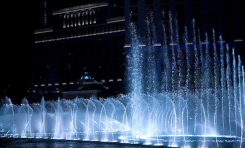 BELLAGIO HOTELS'S WATER FOUNTAINS DANCE IN THE NIGHT SKY IN LAS VEGAS, NEVADA