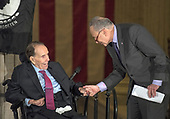 United States Senate Minority Leader Chuck Schumer (Democrat of New York), right, shakes hands with former US Senator Bob Dole (Republican of Kansas), left, prior to making remarks at a Congressional Gold Medal ceremony honoring Dole that was also attended by US President Donald J. Trump in the Rotunda of the US Capitol on Wednesday, January 17, 2017.  Congress commissioned gold medals as its highest expression of national appreciation for distinguished achievements and contributions.  Dole served in Congress from 1961 through 1996, was the Senate GOP leader from 1985 through 1996, and was the 1996 Republican Party nominee for President of the United States.<br /> Credit: Ron Sachs / CNP