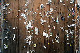 USA, Oregon, Ashland, detail of staples and torn paper advertisements on a message board in the town square in downtown Ashland