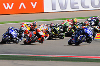 Moto Gp riders taking a curve lead by Jorge Lorenzo