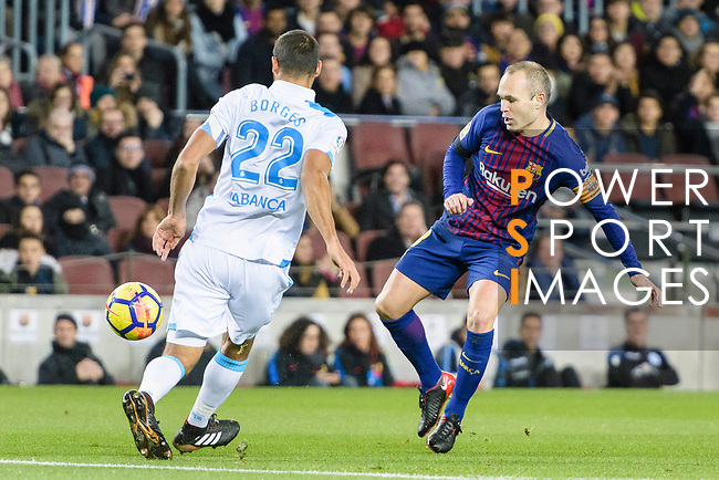 Celso Borges Mora of RC Deportivo La Coruna (L) in action against Andres Iniesta of FC Barcelona (R) during the La Liga 2017-18 match between FC Barcelona and Deportivo La Coruna at Camp Nou Stadium on 17 December 2017 in Barcelona, Spain. Photo by Vicens Gimenez / Power Sport Images