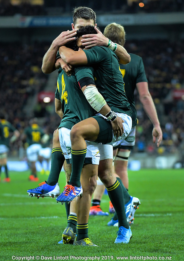 South Africa's Cheslin Kolbe congratulates South Africa's Herschel Jantjies on his last-gasp try during the Rugby Championship rugby union match between the New Zealand All Blacks and South Africa Springboks at Westpac Stadium in Wellington, New Zealand on Saturday, 27 July 2019. Photo: Dave Lintott / lintottphoto.co.nz