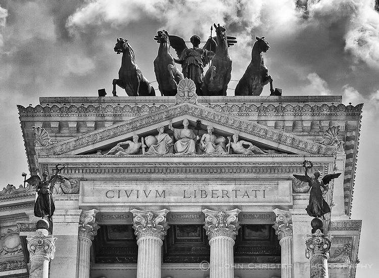 The chiselled incscription above the west colonnade of the Monumento Nazionale a Vittorio Emanuele II