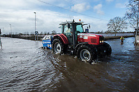 Flooding in the Somerset Levels, village of Burrowbridge. 8-2-14 Environment agency worker in a tractor.