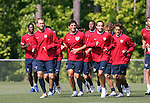 Jimmy Conrad (l), Brian Ching (center), and Landon Donovan (r) lead the team as they jog around the field on Wednesday, May 17th, 2006 at SAS Soccer Park in Cary, North Carolina. The United States Men's National Soccer Team held a training session as part of their preparations for the upcoming 2006 FIFA World Cup Finals being held in Germany.