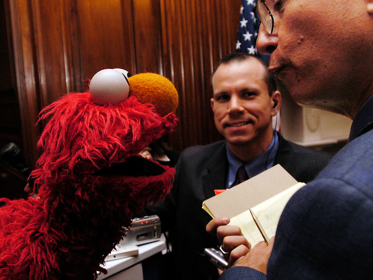 """Sen. Bill Frist, R-Tn., joined Sesame Street's Elmo at a press conference in the Capitol to encourage healthy eating habits for children. Sesame Workshops annoucned a new service campaign, """"Healthy Habits for Life"""" and Sen. Frist, with Sen Ron Wyden, D-Or., also announced a new proposal to reduce child obesity. Afterwards, Elmo took questtions from the media. Here he is grilled by AP's Ira Dreyfuss and PRI's Chad Pergram."""
