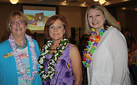 NWA Democrat-Gazette/CARIN SCHOPPMEYER Lynne Keller (from left), Cindy Acre, ERC executive director, and Amber Candur gather at the Beach Bingo Bash.