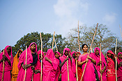The 47-year-old leader of the Pink Gang, Sampat Pal Devi (4th from right)is a fiesty woman. The barely educated, impoverished mother of five, Sampat Pal Devi has emerged as a messianic figure in the region. Sampath Devi began to work as a government health worker, but she quit soon after because her job was not satisfying enough. She always wanted to work for the poor and not for herself. Taking up issues while being a government worker was difficult, so she decided to quit the job and work for the rights of people...Amidst the gloom of extreme poverty, it's the colour of pink that's calling the shots in this dusty region of Bundelkhand, one of the poorest parts of one of India's northern and most populous states, Uttar Pradesh in India. A gang of vigilantes, called the Gulabi Gang (pink gang) - its 10,000 strong women members wear only pink sarees - is taking up lathi (traditional Indian cudgel) against domestic violence and corruption.
