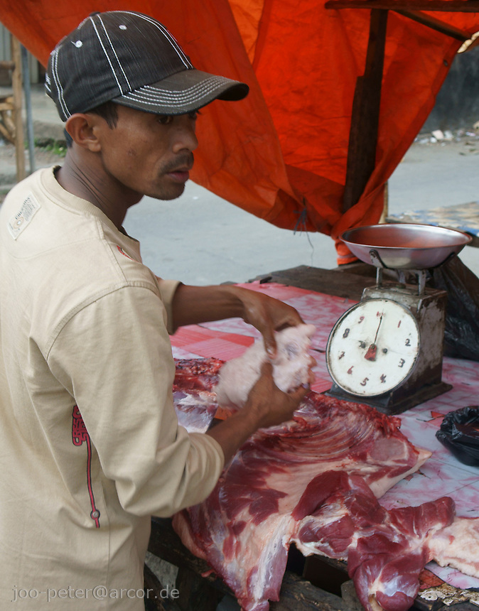 butcher in market streets of Ruteng,  district Manggarai,  island  Flores in archipelago of Indonesia