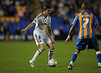 Pictured L-R: Daniel Alfei of Swansea against Mark Wright of Shrewsbury. Tuesday 23 August 2011<br />