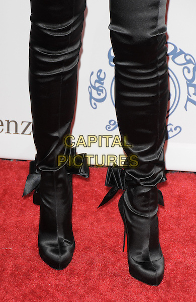 GEENA DAVIS .attends The 30th Anniversary Carousel of Hope Ball Presented by Mercedes-Benz held at The Beverly Hilton Hotel in Beverly Hills, California, USA,.October 25th 2008..detail satin bows heels black over the knee  boots .CAP/DVS.©Debbie VanStory/Capital Pictures