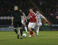 Jonny Hayes being closed down by Paul Dummett in front of referee Stephen Finnie in the St Mirren v Aberdeen Clydesdale Bank Scottish Premier League match played at St Mirren Park, Paisley on 9.11.12.