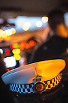 © Joel Goodman - 07973 332324 . 16 August 2013 . Manchester , UK . Inspector Bailey-Smith's hat on the back seat as he drives . Drive along with Inspector Matt Bailey-Smith ( 16366 ) of Greater Manchester Police 's Serious Collision Unit . Photo credit : Joel Goodman