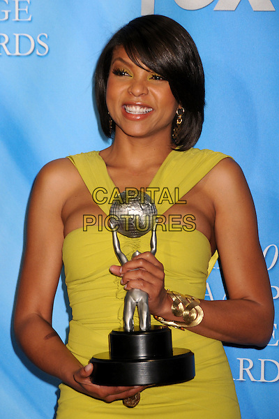 TARAJI P. HENSON.40th Annual NAACP Image Awards - Press Room at the Shrine Auditorium, Los Angeles, California, USA..February 12th, 2009.half length yellow dress gold bracelet award trophy winner .CAP/ADM/BP.©Byron Purvis/AdMedia/Capital Pictures.