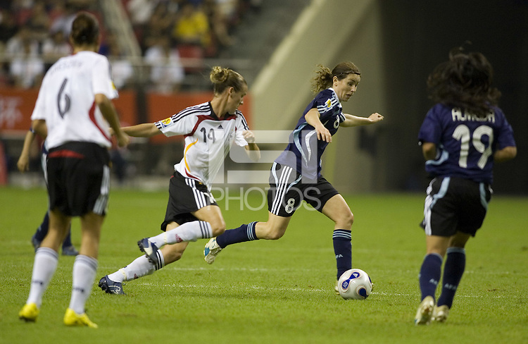 Germany midfielder (14) Simone Laudehr chases Argentina defender (8) Clarisa Huber. Germany (GER) defeated Argentina (ARG) 11-0 during an opening round Group A match of the FIFA Women's World Cup China 2007 at Shanghai Kongkou Football Stadium, Shanghai, China, on September 10, 2007.