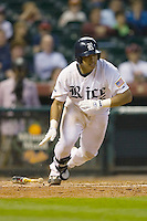 Diego Seastrunk #5 of the Rice Owls follows through on his swing versus the UCLA Bruins in the 2009 Houston College Classic at Minute Maid Park February 27, 2009 in Houston, TX.  The Owls defeated the Bruins 5-4 in 10 innings. (Photo by Brian Westerholt / Four Seam Images)