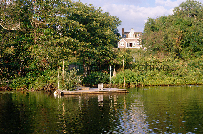 View of the barn from the landing stage on the water at the bottom of the garden