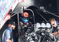 Jun 18, 2016; Bristol, TN, USA; NHRA funny car driver Robert Hight with crew members during qualifying for the Thunder Valley Nationals at Bristol Dragway. Mandatory Credit: Mark J. Rebilas-USA TODAY Sports