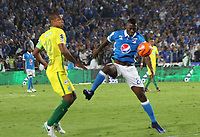 BOGOTA -COLOMBIA, 7-06-2017. Duvier Riascos player of Millonarios fights the ball  agaisnt of  Alexis Henriquez player of Atletico Nacional .Action game between  Millonarios  and Atletico Nacional during match for quarter finals of the Aguila League I 2017 played at Nemesio Camacho El Campin stadium . Photo:VizzorImage / Felipe Caicedo  / Staff