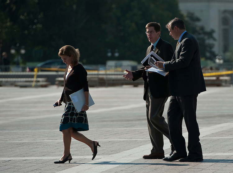 UNITED STATES - SEPTEMBER 22: Sen. Jeff Merkley, D-Ore., right, walks across the East Plaza of the Capitol while talking with two unidentified people on Wednesday morning, Sept. 22, 2010. (Photo By Bill Clark/Roll Call via Getty Images)