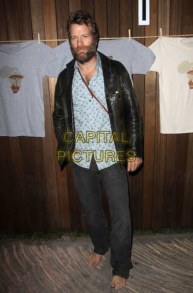 "THOMAS JANE .Official Launch Party for ""Save Darfur Coalition and Propr held At The Propr Store & Jexy, Venice, California, USA..December 17th, 2009.full length jeans denim black leather jacket skirt  barefoot beard facial hair blue pattern shirt.CAP/ADM/KB.©Kevan Brooks/AdMedia/Capital Pictures."