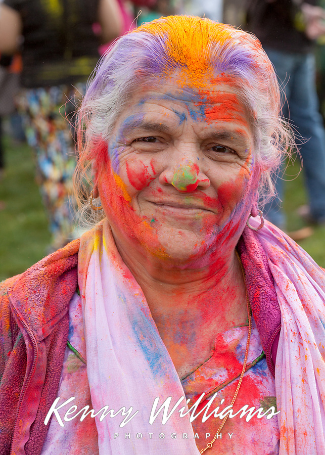 Elderly Woman Coverd with Colored Dye, Holi Festival of Colors, Bellevue, WA, USA.