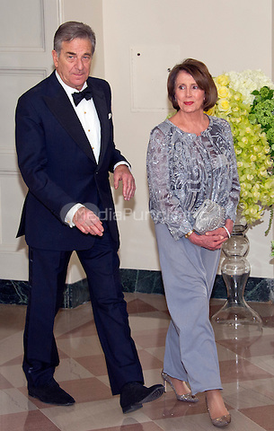 United States House Democratic Leader Nancy Pelosi (Democrat of California) and Paul Pelosi arrive for the State Dinner in honor of Prime Minister Trudeau and Mrs. Sophie Gr&Egrave;goire Trudeau of Canada at the White House in Washington, DC on Thursday, March 10, 2016.<br /> Credit: Ron Sachs / Pool via CNP/MediaPunch