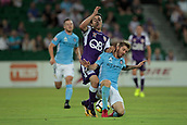 9th January 2018, nib Stadium, Perth, Australia; A League football, Perth Glory versus Melbourne City; Jacob Italiano of the Perth Glory is bought down in a tackle by Luke Brattan of Melbourne City during the first half
