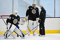 June 26, 2018: Boston Bruins goalie Jeremy Swayman (70) and goalie Dan Vladar (80) with a member of the coaching staff during the Boston Bruins development camp held at Warrior Ice Arena in Brighton Mass. Eric Canha/CSM