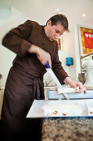 Chocolatier Patrice Arbona at work making nougat in his shop 'Entre Mes Chocolats', Vence, France, 10 February 2011