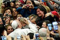 Papa Francesco bacia un bambino al suo arrivo ad un'udienza ai fedeli della diocesi di Cassano allo Ionio in Aula Paolo VI, Citta' del Vaticano, 21 febbraio 2015.<br /> Pope Francis kisses a baby as he arrives for an audience to members of the diocese of Cassano allo Ionio, in the Paul VI hall at the Vatican, 21 February 2015.<br /> UPDATE IMAGES PRESS/Riccardo De Luca<br /> <br /> STRICTLY ONLY FOR EDITORIAL USE
