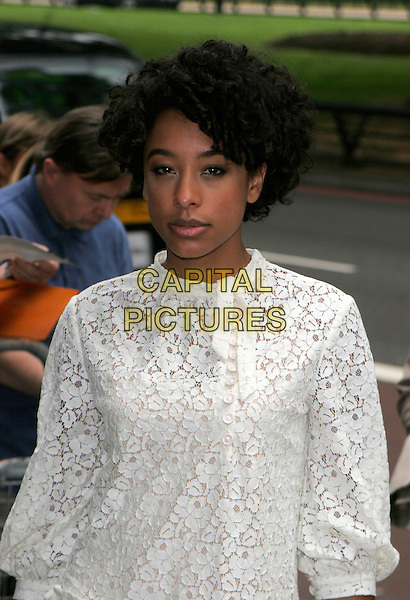 CORINNE BAILEY RAE.Arrivals at the Ivor Novello Awards, Grosvenor House, London, England..May 24th, 2007.half length white dress lace .CAP/AH.©Adam Houghton/Capital Pictures